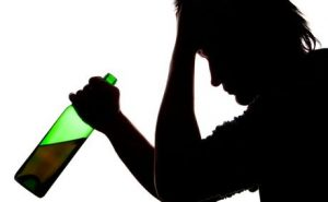 Alcohol being drunk by young person