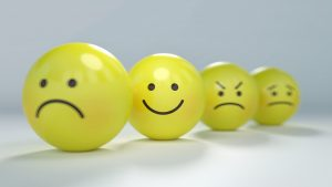 yellow emoji balls showing different emotions relating to dyslexia support